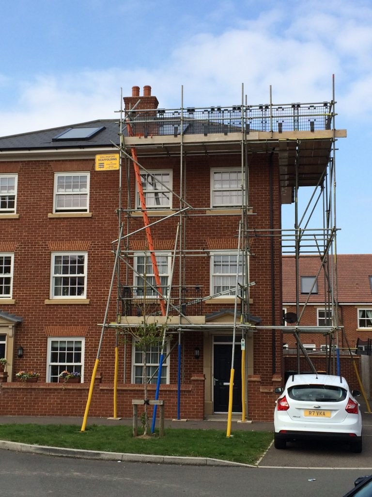 Scaffold at side of house
